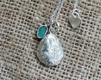 Sand cast silver sea shell with sea glass