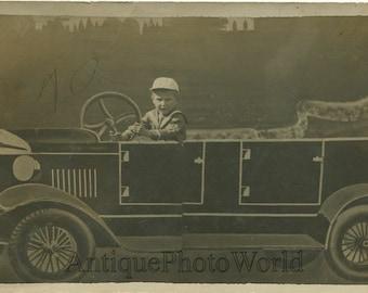 Boy in fake automobile car antique rppc photo