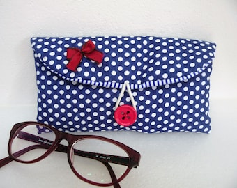 Blue fabric glasses case with white polka dots