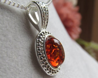 10x8mm Baltic Amber Cabochon Pendant in Silver Plate with Sterling Silver Chain