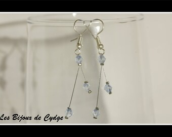Earrings on twisted wire and its light blue bicone bead