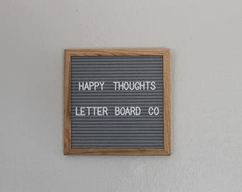 "Gray felt letter board 10""x10"" white plastic letters,numbers,symbols"
