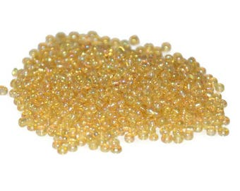 10 grams seed beads yellow iridescent Rainbow glass 2mm approximately 800 beads (ref23)