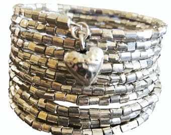 Silver wrap bracelet with heart charm