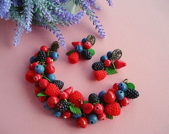 Bracelet and earrings with figures of berries and leaves of polymer clay