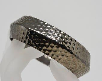 Lovely silver tone bangle bracelet
