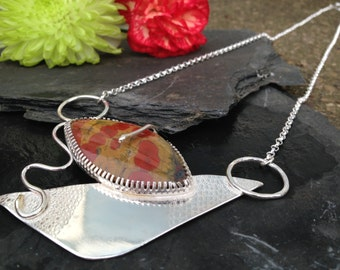 British handmade silver Picasso inspired pendant with a poppy jasper stone, hanging from a chunky chain