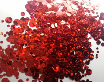 Immortal is a beautiful shimmery red dot glitter mix in a 10g pot.