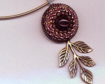 Beaded Pendant . Amethyst & Garnets . January Birthday . Eye Pendant . Antique Brass Branch - The Desert Princess by enchantedbeas on Etsy