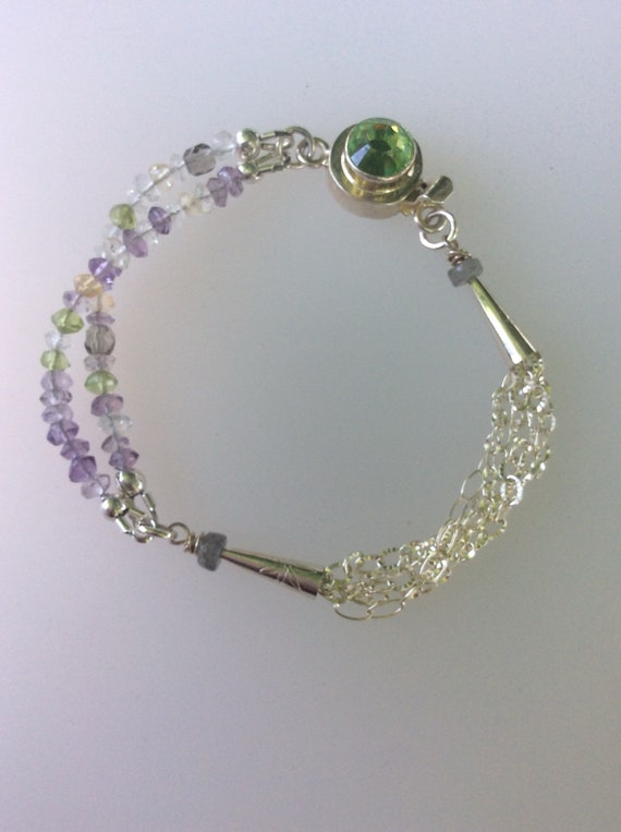 Sterling silver chain bracelet with tiny faceted tourmaline gemstones.