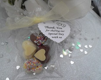 100 bags of personalised Callebaut chocolate heart wedding favours