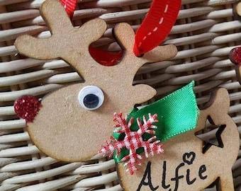 Wooden reindeer tree decoration.