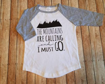 The mountains are calling and I MUST go!!! Available in other colors! Baseball style raglan tee!