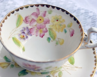 Royal Standard Lorraine Pink Purple and Yellow Flowers with Scalloped Gold Edging Teacup and Saucer