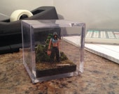 She was always a quiet girl. A 2 inch diorama cube