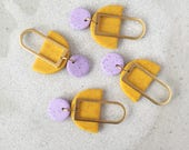 Mabel Earrings - Speckled Lilac & Glitter Yellow with a brass rectangular silhouette.