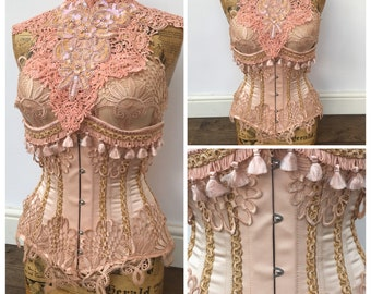 Peach satin under bust corset adorned in lavish lace and trim