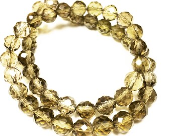 """14"""" Strand of 8 mm Faceted Round Whiskey Quartz Beads"""