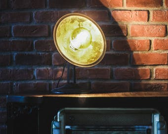 Old heating transformed into a lamp table