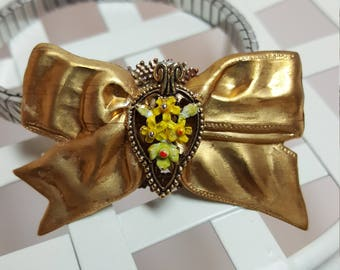 Re-purposed, upcycled assemblage vintage stylehearet and bow stretch band bracelet