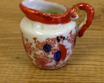 Vintage Tiny Oriental Jug. Handle has been broken and repaired otherwise in good condition