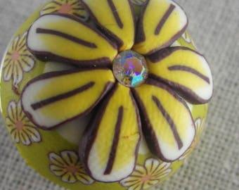 Bouton pression fleur jaune