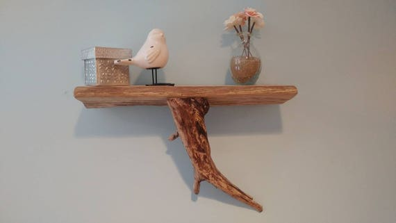 Handmade wall shelf made with driftwood top and driftwood accents.