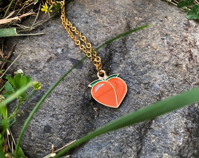PEACHY KEEN: peach charm on plated stainless steel chain