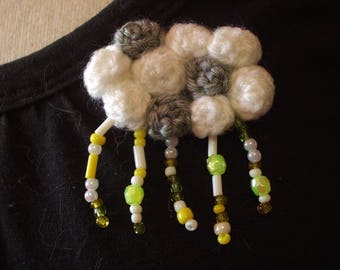 crocheted in white/gray and rainy cloud brooch