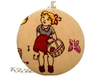 Girl with basket of apples fabric pendant and long silver chain