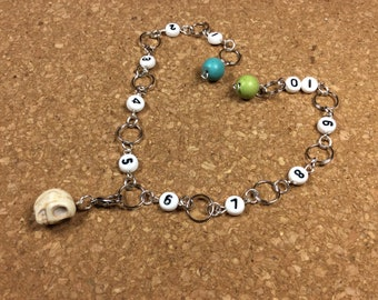 Row Counter - Number Row Counter for knitting or crochet - Counts to 100 - skull stitch marker - stitch saver - 11 us - crochet row counter