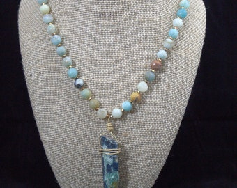 Kyanite and mica pendant on an Amazonite and hematite necklace with waxed navy linen cord.
