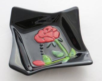 Black origami dish with red rose