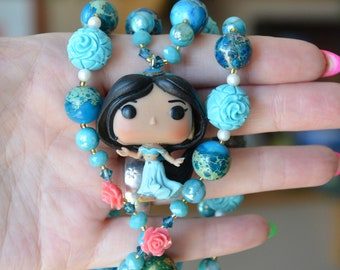 Les Roses de Jasmine - Long turquoise, white and pink necklace with Arabian princess pendant.