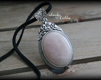 Rose Quartz gemstone necklace with wild leather strap