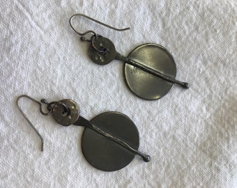 Hand forged oxidized copper earnings with up cycled washer component .