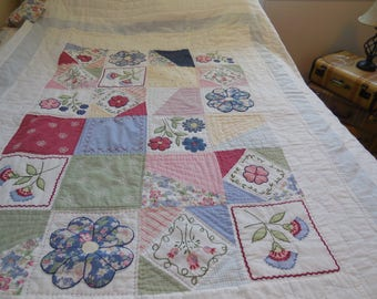 Quilt, hand quilted with very nice embrodery in the squares.