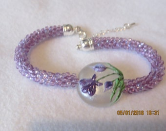 0013-Lavender Kuhihimo Bracelet with a Hand Blown Glass Center Stone