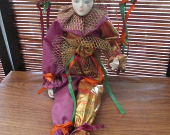 1980s Porcelain China Jester Clown Doll Ornament wearing Gold  and Purple Clothes
