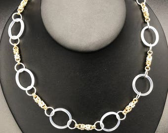 White agate rings interspersed with Byzantine chain maille weave