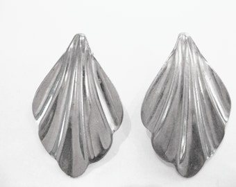 Vintage silver metal clip on earrings Scalloped Wing design