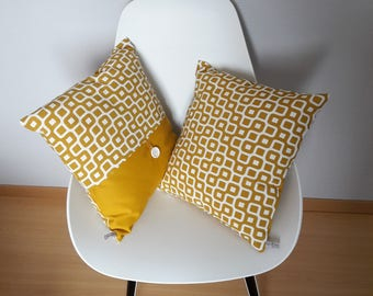 Pillow cover with geometric patterns in mustard yellow and beige