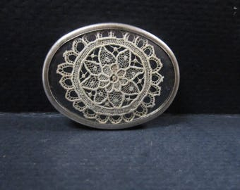 Silver brooch with very fine embroidery