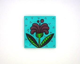 tout petit tableau - printemps - fleur bordeaux sur fond turquoise