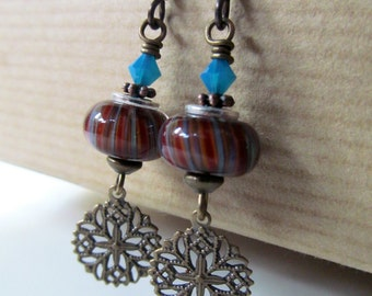 Red, Orange and Blue Lampwork and Teal Crystal Beaded Niobium Earrings