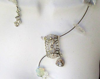 Misty, silver asymmetrical,wraparound,  rhinestones, crystals, geometric, handmade, contemporary,textured, ,sculptural,