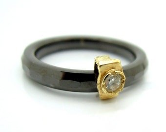 Black ceramic ring with a zircon set in 9K Gold