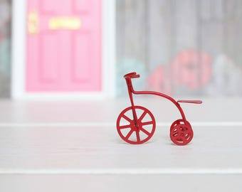 Red tricycle Miniature accessory. Accessory Ratóncito Pérez. Accessory fairy of the Teeth.