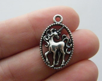 4 Unicorn charms antique silver tone A14