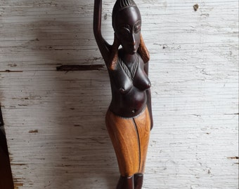 """Tribal Carving of an African Woman. This carving stands 25"""". It is a hard wood. Very nicely done."""